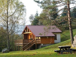 1. Superbe chalet traditionnel en lisiere de foret