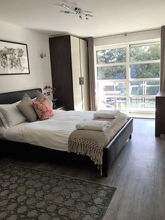 Master bedroom with double doors to south facing balcony