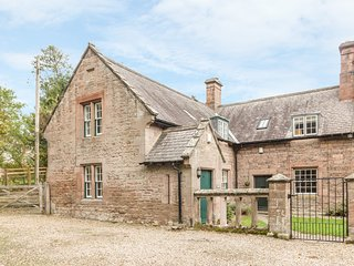 GARDENER'S COTTAGE, stone cottage with woodburner, near stream and castle, in