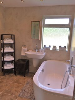 Large luxurious family bathroom with deep bath,double(power) shower,large towels& starter toiletries