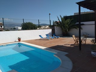 Villa with snow capped mountain views, looking over Granada city, Andalusia