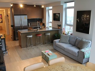 Stylish & Bright Corner Unit + View in the Heart of Trendy Mount Pleasant