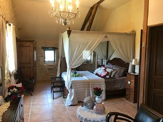 Master ensuite bedroom with four poster bed