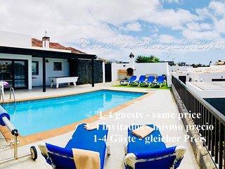 Villa Neptuno con piscina privada, Sat-TV, Wifi & barbacoa  en Playa Blanca