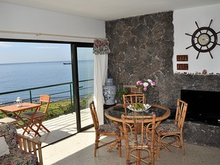 Spectacular views, heated pool, sauna, natural beach...
