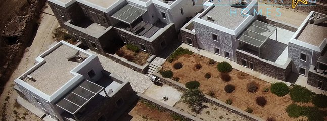 Drone view of our complex of summer homes at Sifneikos gyalos, Antiparos. Just 100m from the beach and 5 minutes walk...