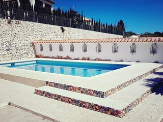 Newly refurbished pool. Sun all day. Pool shower and toilet.Steps into pool.Deep and crystal clear!
