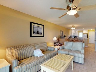 NEW LISTING! Dog-friendly townhome w/ shared pool, screened-in porch, gulf views