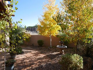 Front courtyard in October with fountain. There is an even larger fountain out back.