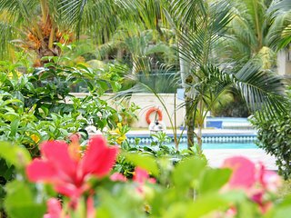Cozy apartment nested in a tropical garden
