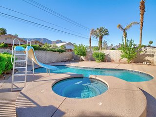 Dog-friendly desert escape with private pool, water slide, and bubbling hot tub