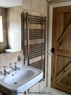 The downstairs walk-in shower room