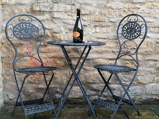 Enjoy a glass of something nice in the courtyard