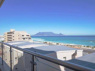 NEW LISTING! Modern condo w/balcony & views of ocean/Table Mtn -1 block to beach