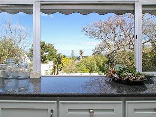Elegant home w/ beautiful views, private pool, & yard - close to parks & beach