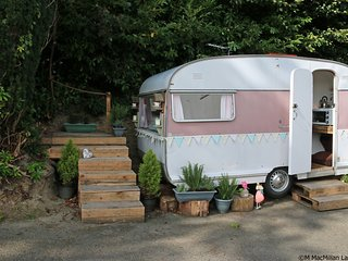 Jemima is a 1958 Cygnet touring caravan, now sited permanently here at Woodlands