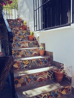 The Spanish inspired steps up to your apartment.