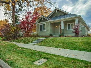 NEW LISTING! New house w/fireplace, back porch & lawn -walk to lake/dining/shops