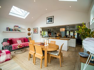 Dining room - leads onto sunny deck and fire pit area