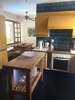Kitchen view towards breakfast area overlooking pool