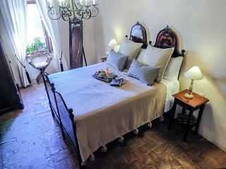 The romantic queen size bed is located in the 11th Century tower