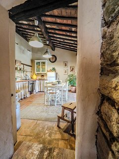 A peep through to the charming rustic kitchen