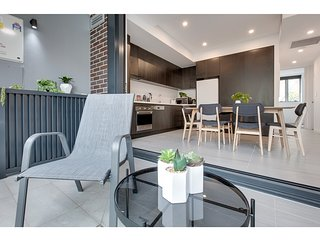 Centrally located modern apartment steps from city