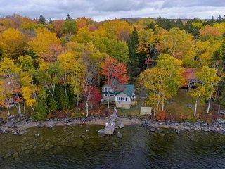 Vintage lakefront cabin w/ incredible water views, private dock & pebble beach