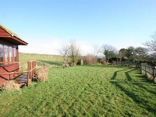 1 EASTON BARN, pet-friendly barn conversion, large garden, close to sandy beache