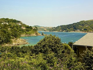 DOLPHINS, spacious two storey property, superb sea, estuary and countryside view