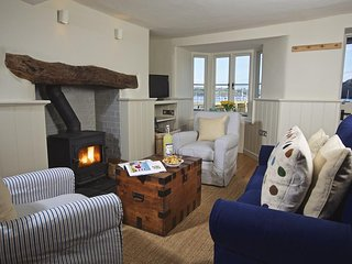 BERRY COTTAGE, river views, wood-burning stove, two en suites, waterside setting