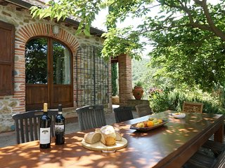 Shaded dining terrace outside front of house