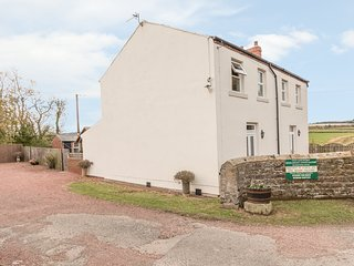 ST CUTHBERT'S COTTAGE, welcoming cottage, with three bedrooms, decked area, coun
