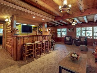 Beautiful 2-story log cabin with hot tub, large deck, and fire pit