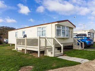 6 berth caravan near amenities with part sea view. *Pet friendly. REF 20217