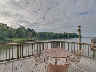 NEW LISTING! Lakefront family home in gated community w/swimming area & dock