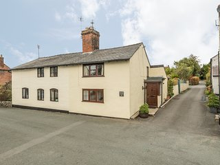 PEAR TREE COTTAGE, 19th century cottage, enclosed patio, ideal for a family or