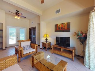 Lagoon-front, ground-level condo with shared pool - walk to the beach