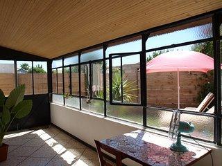 Maison F2 avec verrière et petit jardin