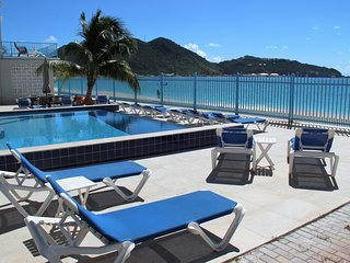 Pool deck area with plenty of loungers is thirty feet from your back door..