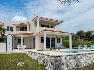 Akumal Villa Surrounded by Caribbean coastline and aquamarine ocean.