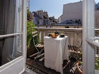 Paris center sunny balcony