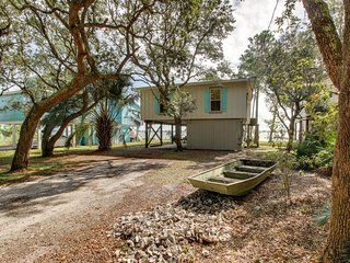 NEW LISTING! Lagoon-front home w/tiki bar, kayaks & dock/boat lift-near beach