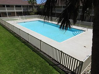 Fully remodeled condos! Large pool! Only a block to the beach!