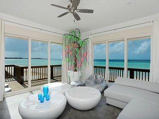 New & Luxurious Private Villa Suspended Above Pink Sand Caribbean Beach