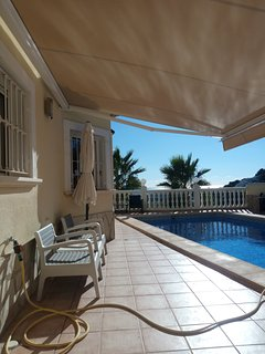 Pool terrace with automatic awning
