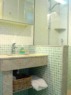 Second bathroom with large walk in shower.