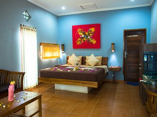 Spacious and bright bedroom with sitting area