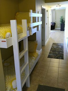 Bunk beds in hallways are fun for smaller children.