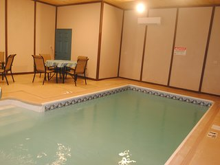 Private indoor pool.6 bedroom (incl. bunk room), 4 bath log cabin. Sleeps 18